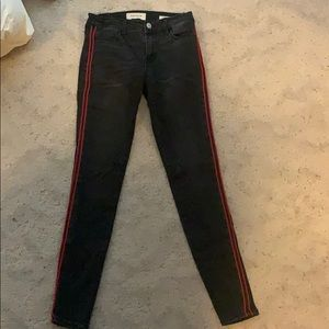 Black low-rise jeans with red detail
